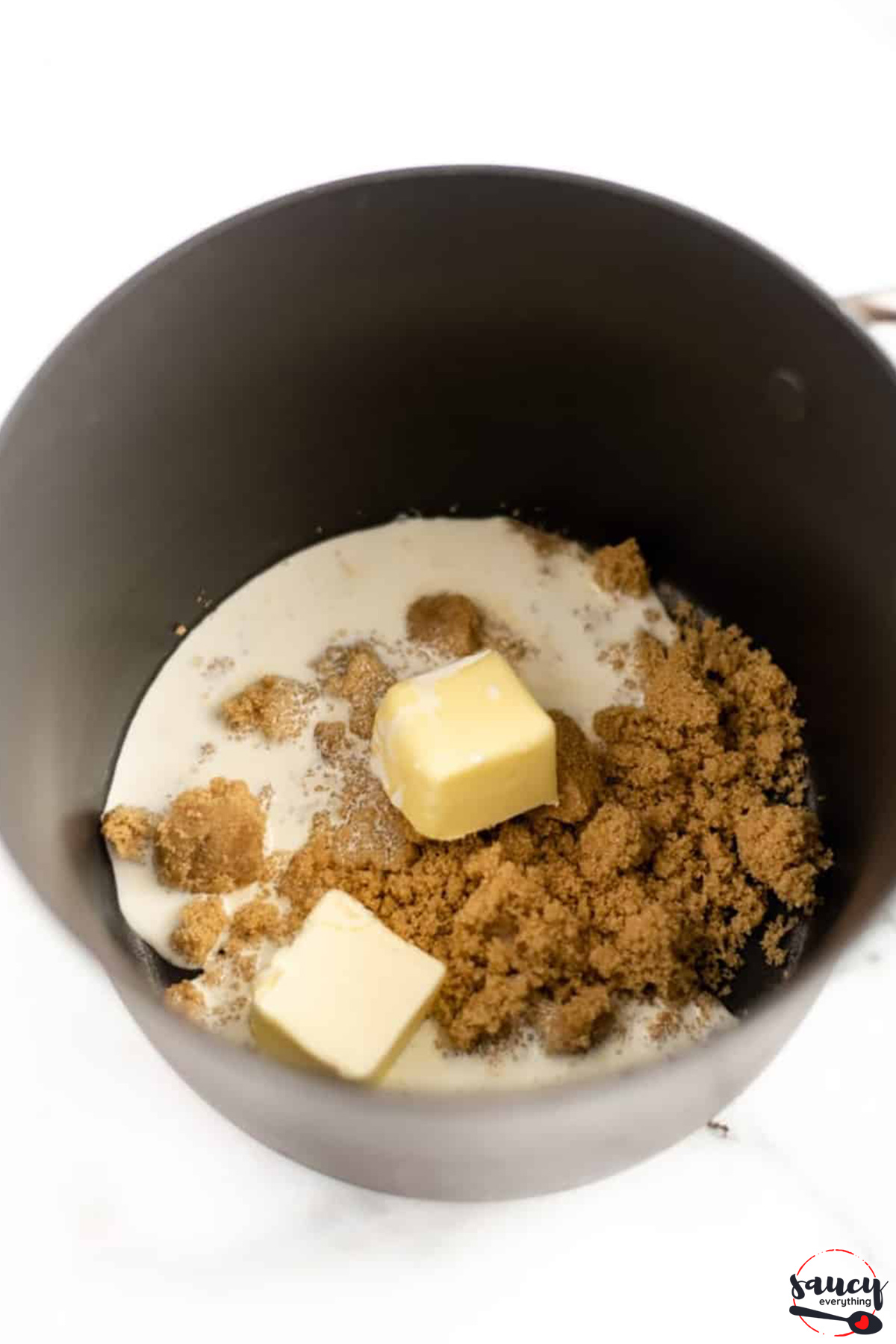 Ingredients to make butterscotch sauce in a pot