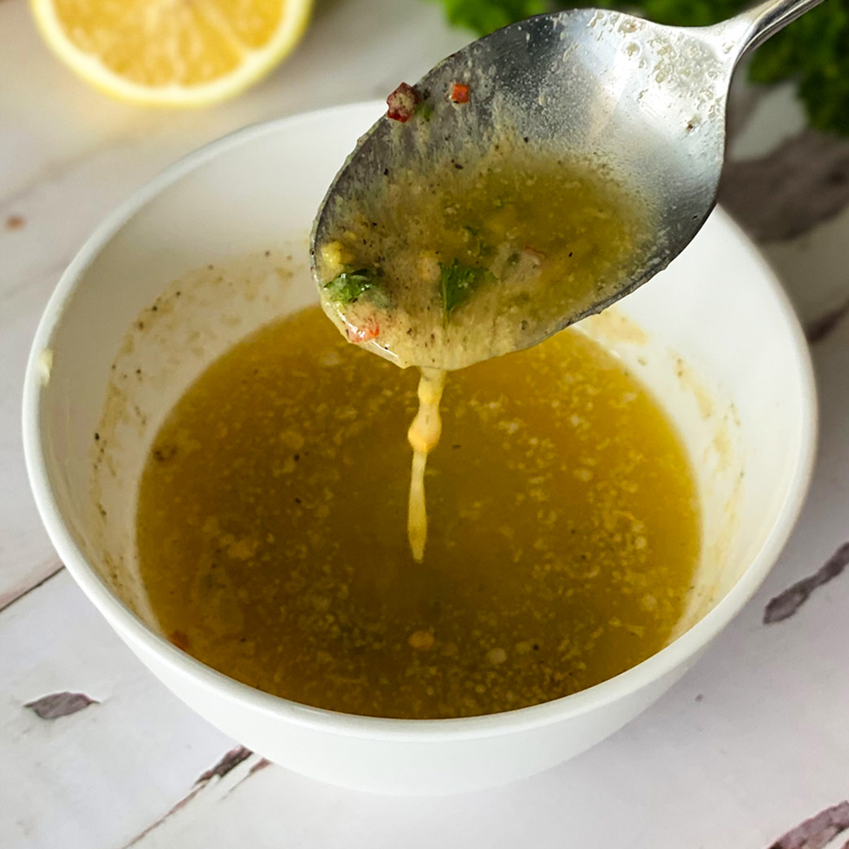 cowboy butter sauce dripping from spoon