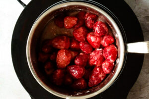 Strawberries added to a saucepan