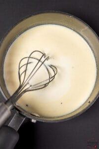 Stirring garlic cream sauce