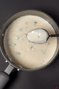 Garlic cream sauce in a sauce pan