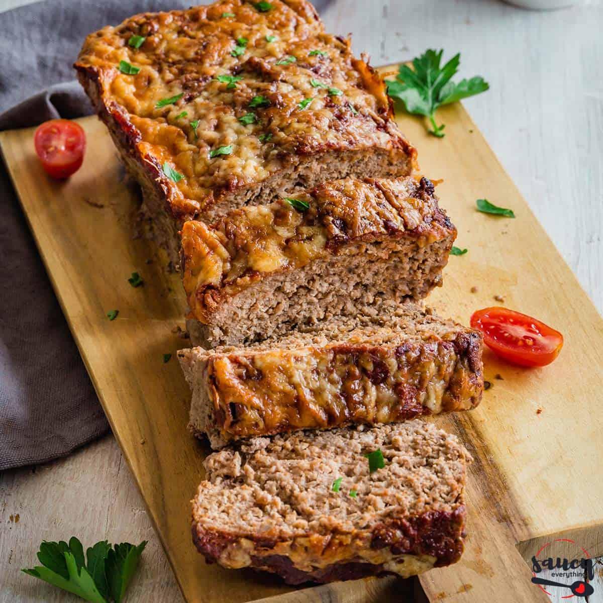 meatloaf sliced on a wooden serving board