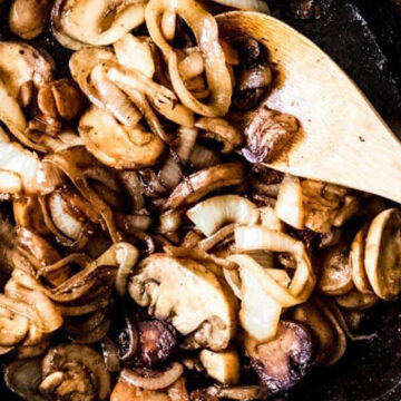 Mushrooms and onions sauteed in a cast iron pan