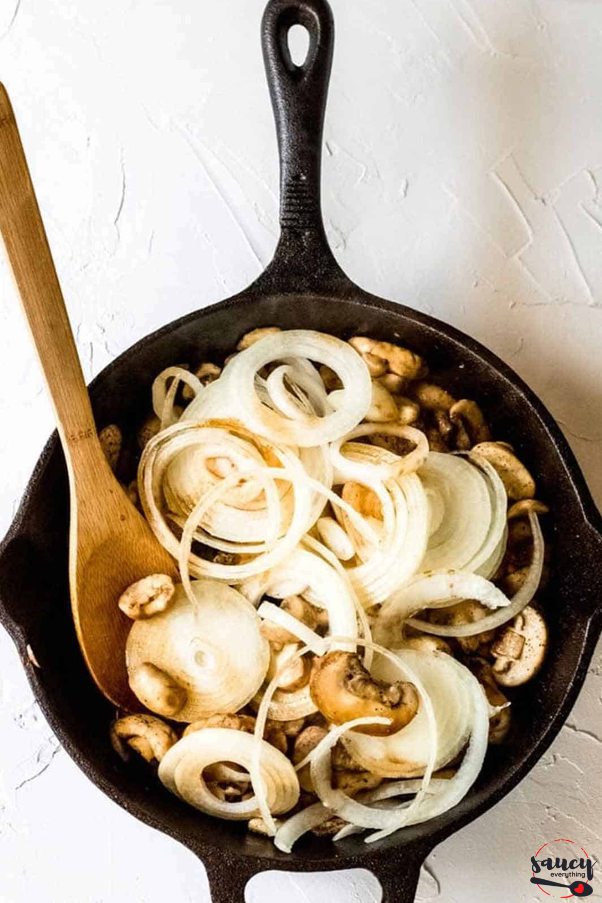 Mushrooms and onions in a cast iron pan