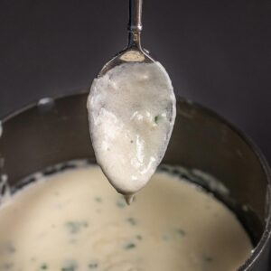 cheese sauce on a spoon