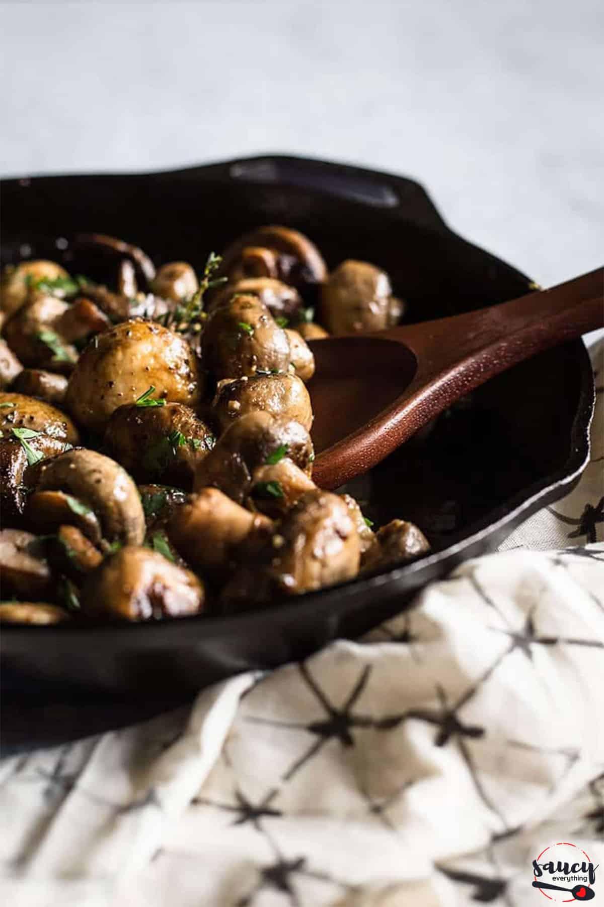 garlic butter mushrooms in a skillet