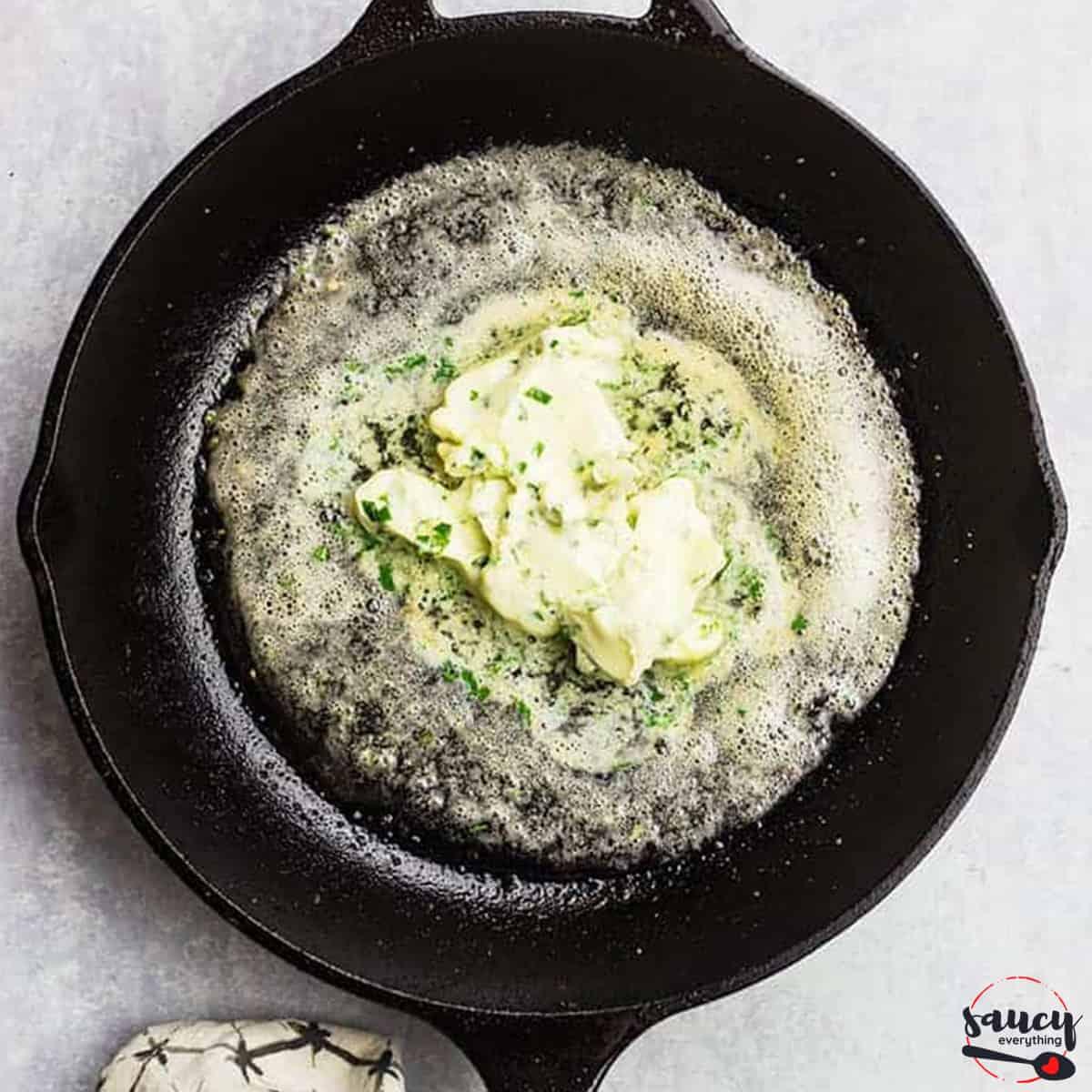 garlic butter sauce melting in a skillet