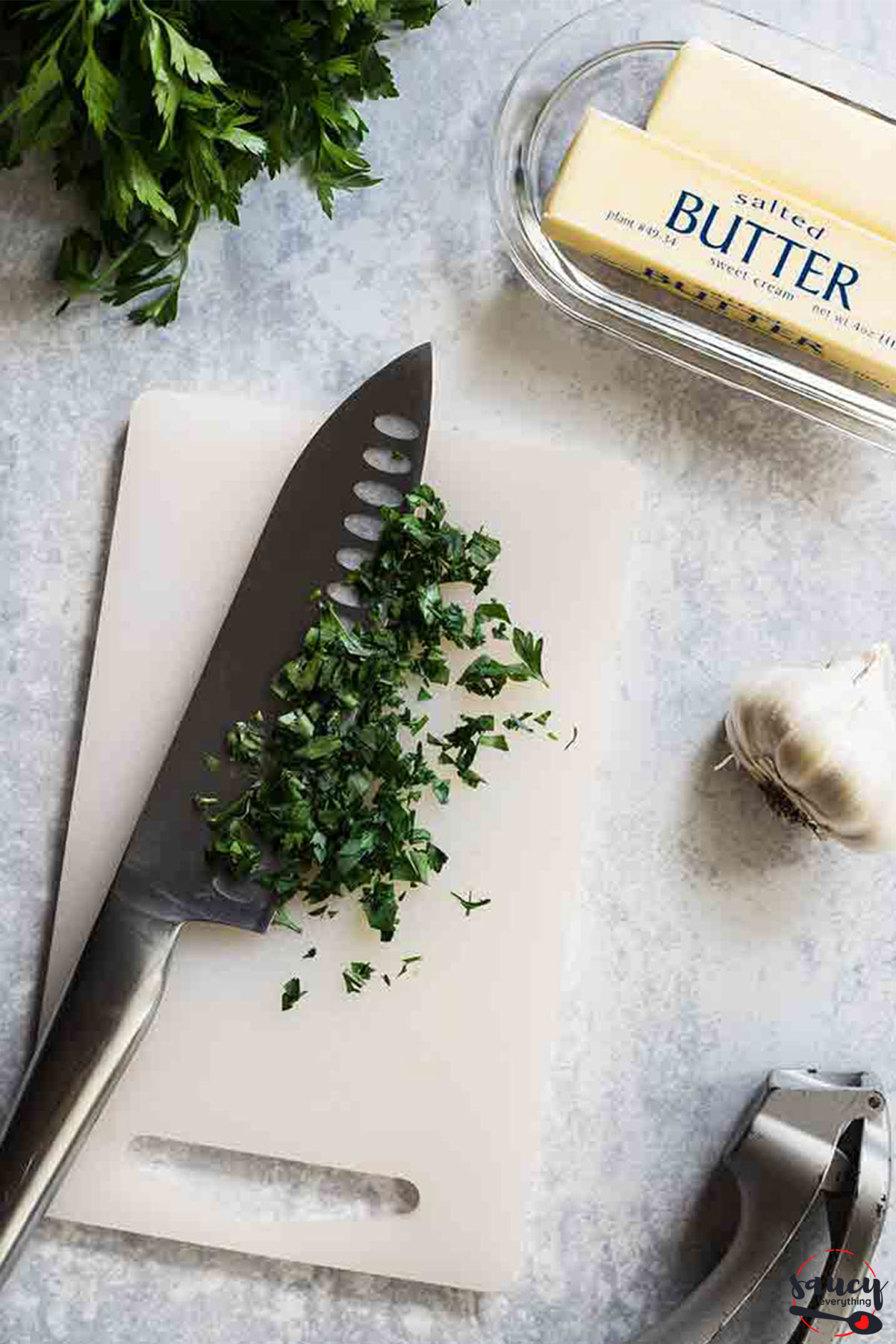 chopping parsley for garlic butter
