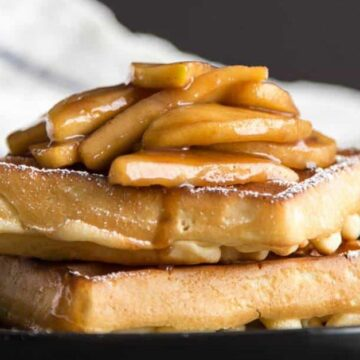 Sauteed apples on a stack of two waffles
