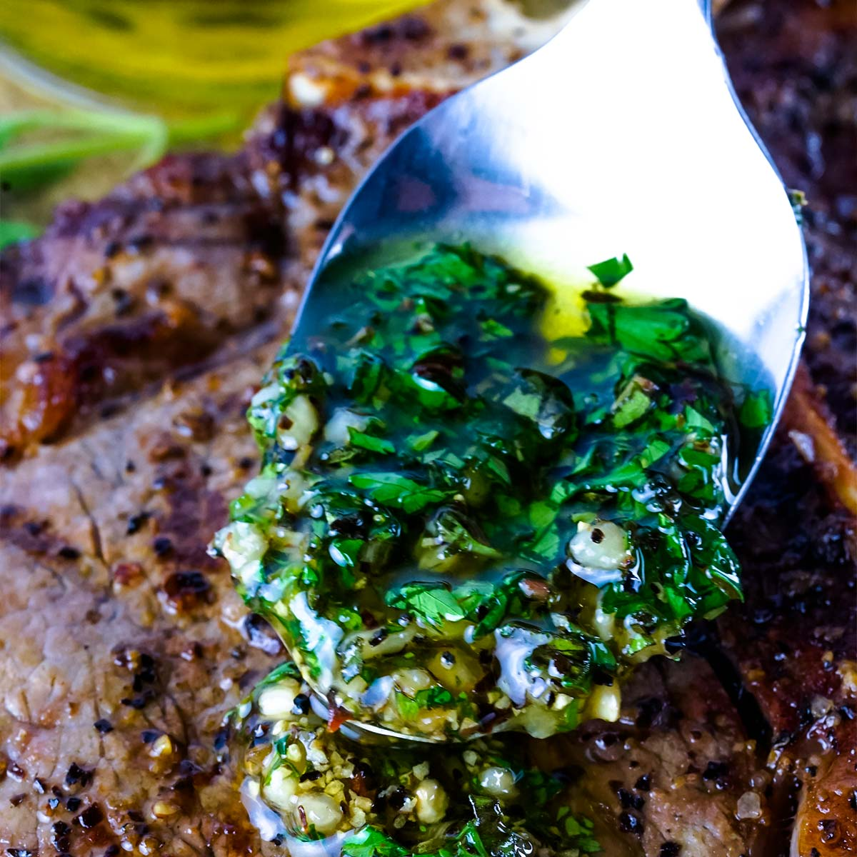 Chimichurri sauce on a spoon close up